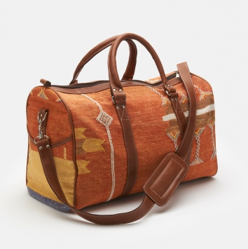 These Recycled Kilim Weekender Bags from Rodale come in three patterns and have leather trim and a detachable handle. $450