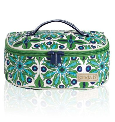 We're long-time fans of the colorful, durable bags from Cinda b where you can find anything from golf head covers to zip wallets to a variety of travel bags. This colorful train case in the Verde Bonita pattern is $65.