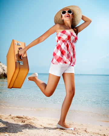 woman-on-beach-with-suitcase